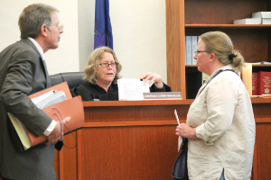 School charges dismissed, lawsuit pending